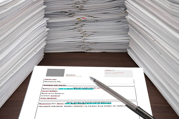pen and blank paper besides piles of documents; Shutterstock ID 297784067