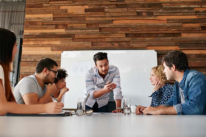 Brainstorming in a boardroom of creative office . Young creative people sitting at the table and discussing new projects.; Shutterstock ID 365534846